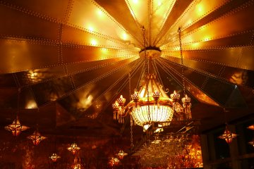 <p>The beautiful ceiling illuminated with a golden chandelier.</p>