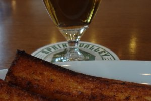 Garlic toast and their traditional beer, Spring Valley