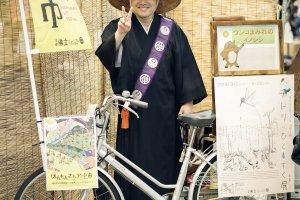 A Japanese story-teller right outside the shrine, all the kids love him.