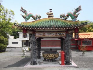 The small but vibrantly colorful pavilion is home to eight dragons