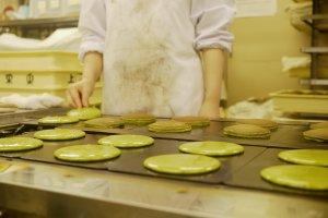 Carefully preparing the matcha pancakes.