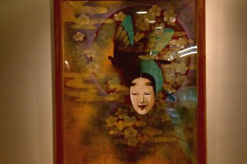 <p>Noh-mask painting decorating the wall in the hotel lobby</p>