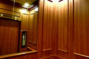 Interior of the hotel elevator is chic wood
