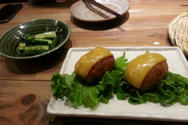 Cucumber salad and cheese/bacon wrapped onigiri (rice balls)