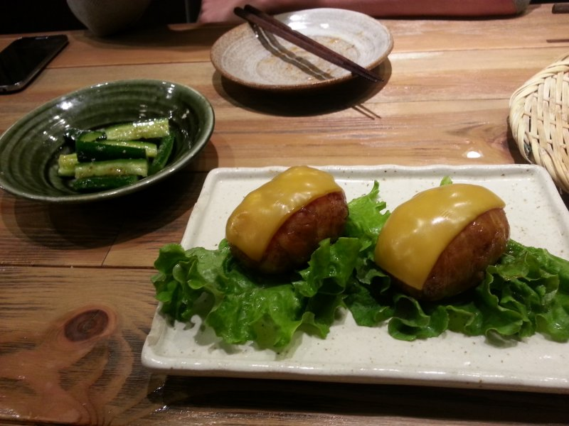 <p>Cucumber salad and cheese/bacon wrapped onigiri (rice balls)</p>