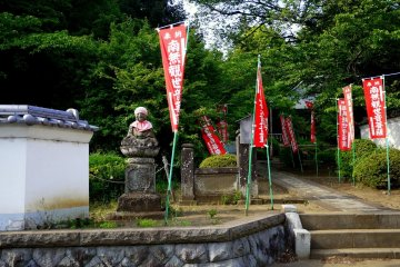 <p>Red banners on either side of the path</p>