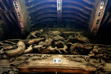 <p>A fantastical dragon broods under the eaves</p>