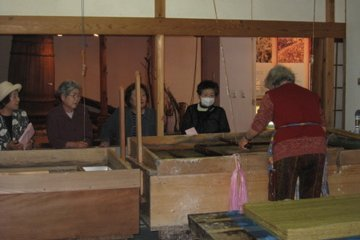 Women watching worker