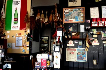 <p>Dried ham and various food items decorate this Italian eatery</p>