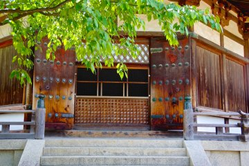 <p>Darkness behind the heavy doors of Yume-dono Hall</p>