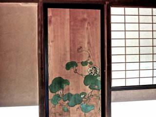 Lovely lotus leaves painted directly onto a wood door in one of the villa's teahouses