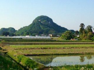 Iwayama rising out of the fields of Kanuma