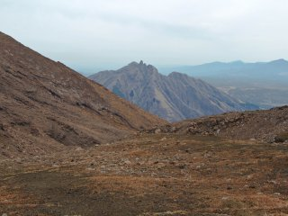 Climbing Naka-dake, the peak right next to the steaming caldera, spoils you with excellent views of the whole area.