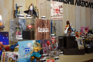 One Piece figurines display nearby the Amusement Arena