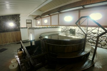 <p>A barrel onsen inside the hotel</p>