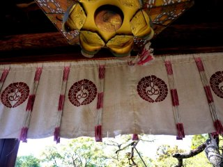 Metal lantern and curtains hanging in the gate