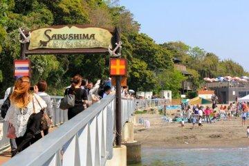 Beachgoers disembark Mikasa ferry boat toSarushima Island in Yokosuka