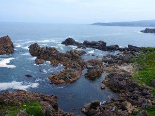 The rocks cluster in miniature archipelagos