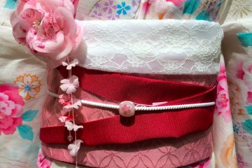 <p>Get creative with your Obi by folding it up and then adding an&nbsp;Obi-Jime &amp; Obi-Dome. A decorative string &amp; charm tied around the center of the Obi.</p>