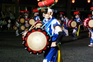 The traditional hat and costume is worn by this performer
