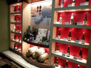 Bottles of local Fukui sake adorn the hotel corridor