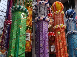 Each group of streamers are decorated by various city shops, schools or civic organizations