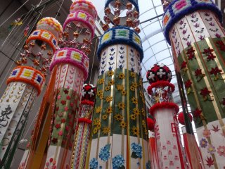 The streamers hang from ten meter long bamboo poles in the city's covered shopping arcades