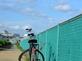 A lone bike at riverside pathway of Senrigawa river, Toyonaka, Osaka.