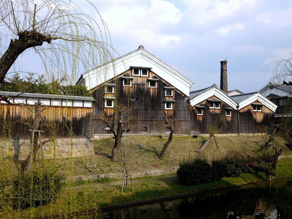 Gekkeikan sake warehouse stands on the bank of the canal
