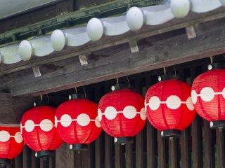 Shop eaves adorned with lanterns