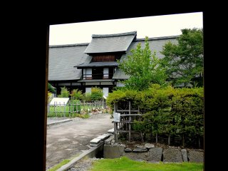 View of the big house framed by the gate