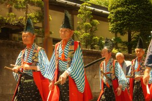Another example of traditional dress, fifty different styles are displayed in the procession