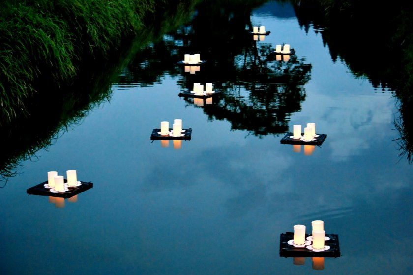 Lit-up lanterns flowing down the Ichijodani River