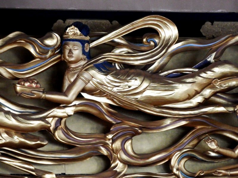 <p>Beautiful gold carving of a flying Goddess of Mercy</p>