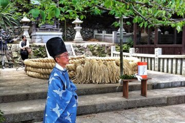 The completed rope is transferred to the shrine on Kashima Island, where it sits, coiled like a snake for a blessing