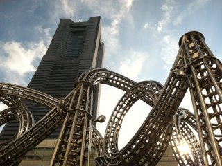 A roller coaster structure in front of Landmark Tower