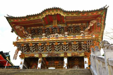 <p>When you pass by the five-storied pagoda, and then climb a set of stairs, you&#39;ll see this Koyomon Gate</p>
