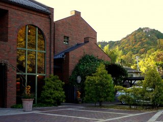 The shop and cafe are housed in a graceful red brick building. You can see Omihachiman's cable car in the background.