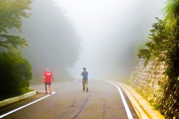 <p>A scene from `Silent Hill` perhaps? The dense foggy mountain roads create an eerie atmosphere</p>