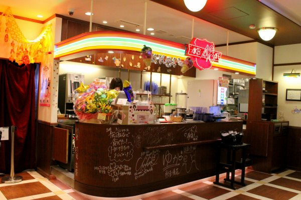 The colorful counter in the cafe is covered with autographs of the AKB48 members