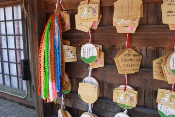 <p>Closer look of the emas (wishing plaques) and some senbazuru (1000 origami cranes)</p>
