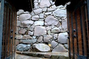 Stone walls framed by a gate