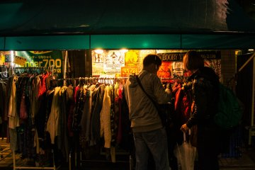 <p>Shoppers looking at thrift stores even at night.</p>