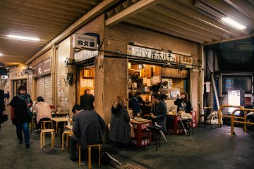 <p>Locals grab a drink and a bite to eat at this small joint under the train station.</p>