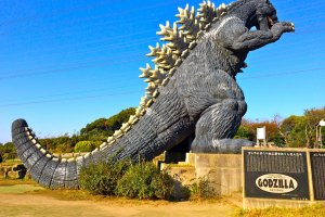 The slide of Godzilla runs through its long and scaly tail