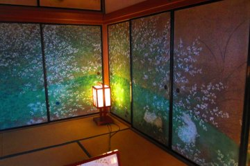 Brightly colored cherry blossoms decorate a wall-screen inside