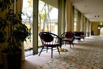 <p>Tea tables by the window right next to the lobby</p>
