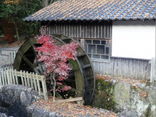 A waterwheel sits right next to the shuttle bus stop for Kunenan