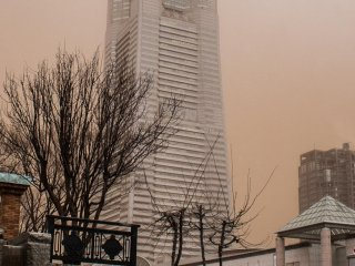 The sky's brownish color is actually red sand from China!