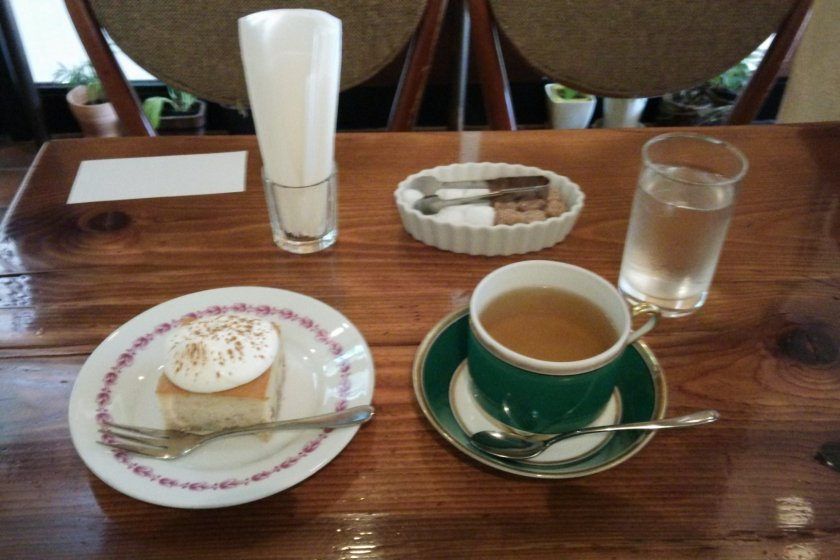 Delicious walnut and banana cake, with cream and cinnamon, and herb tea